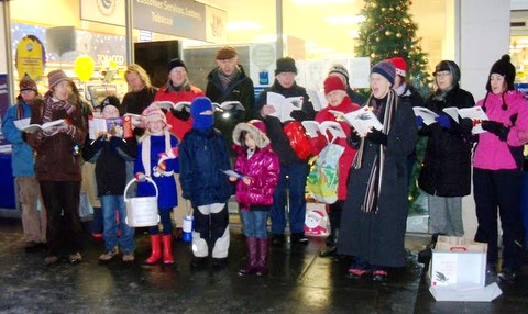 Carol singing outside Tesco in Ballards Lane