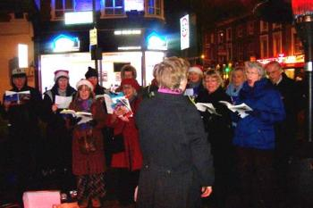 Carol singing outside the Dignity