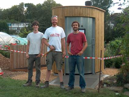 Picture of Joel, Michael and James of Kazuba UK in front of the Kazubaloo at Gordon Road Allotments