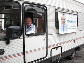 Mike Freer in his Minibus