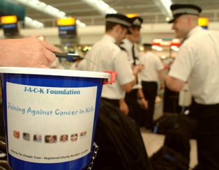 Photo of police collecting money for their charity