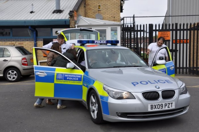 Photo of children playing in a police car