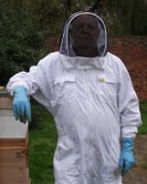 Photo of a beekeeper in all his regalia!